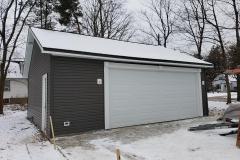 mayfield-siding-custom-trim-entry-garage-door